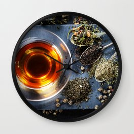 Tea composition with old spoon on dark background Wall Clock