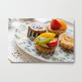 Small fruit tarts laid out on an antique china plate Metal Print