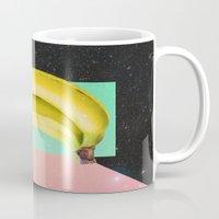 eat Mugs featuring Eat Banana by Danny Ivan