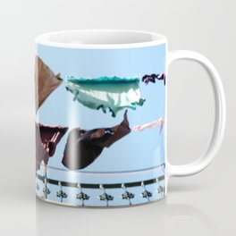 Hanging laundry in blowing wind Coffee Mug