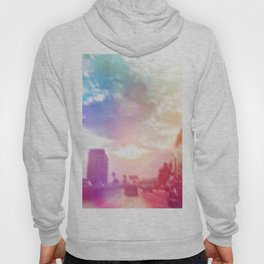 blue cloudy sky on the road with colorful bokeh light abstract Hoody