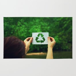 holding recycle symbol Rug