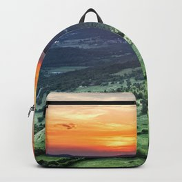 Beautiful sunset behind green fields Backpack