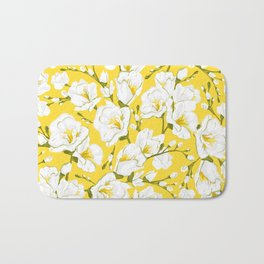 White freesia on a yellow background Bath Mat