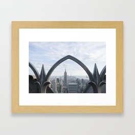 Empire State seen through an iron fence Framed Art Print