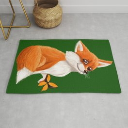 Cute fox playing with a butterfly Rug