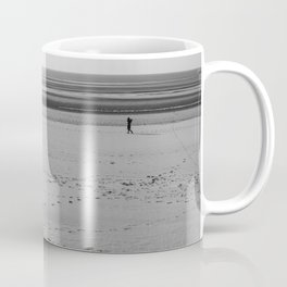 Beach in winter with some walkers Coffee Mug