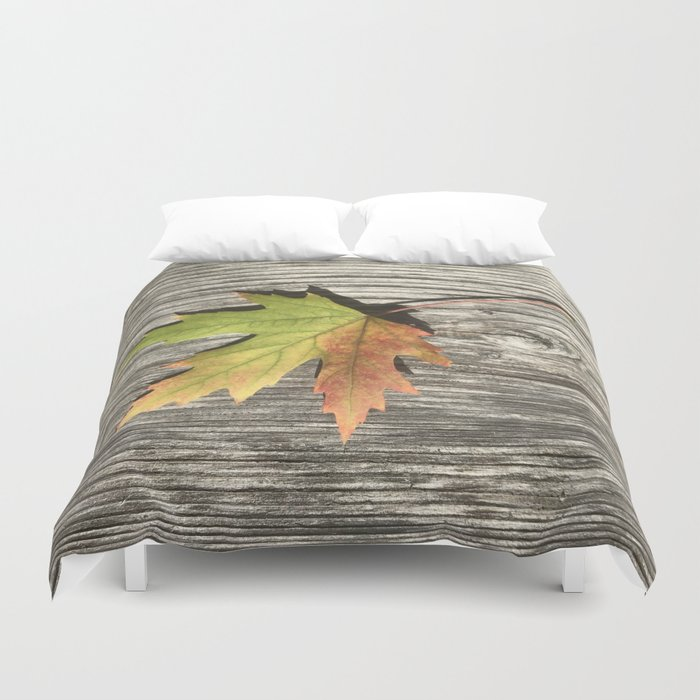 Fall leaf on weathered wood Duvet Cover
