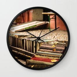 Old books on the street Wall Clock