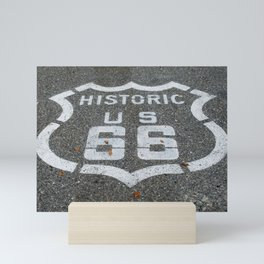 Route 66 sign on the road Mini Art Print
