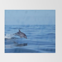 Spotted dolphin jumping in the Atlantic ocean Throw Blanket