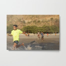 Timorese people play football in Areia Branca beach Metal Print