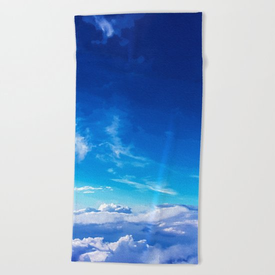 Above the clouds sky is always blue Beach Towel
