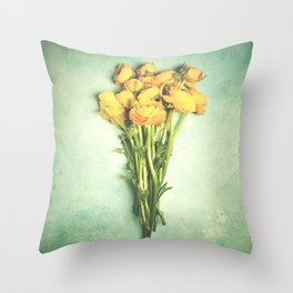 Yellow ranunculus flowers close-up on a blue table Throw Pillow