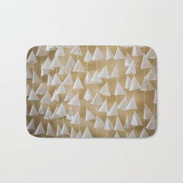 paper cones hanging on strings texture on the wall Bath Mat