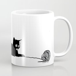 Black cat with ball Coffee Mug