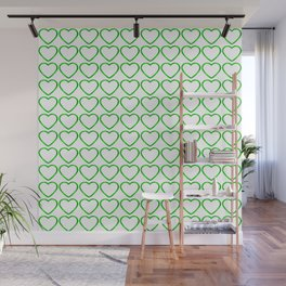 Strict sparkling pattern of green hearts on a light background. Wall Mural
