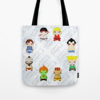 street fighter Tote Bags featuring A Boy - Street fighter by Christophe Chiozzi