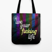 yolo Tote Bags featuring #YOLO by Shipwreck Moon Designs