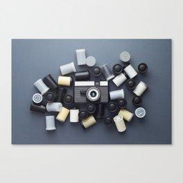 Vintage Photo Camera and photo film rolls Canvas Print