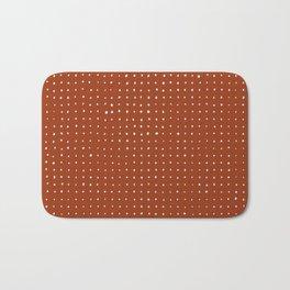 Light grey dots on rust Bath Mat