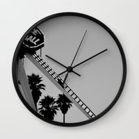 dragon ball Wall Clocks featuring Fire Ball by Katie Katherine Designs