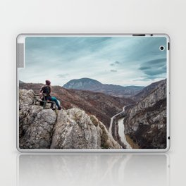 Girl sitting on the bench on the edge of the canyon with amazing view in front of her Laptop & iPad Skin