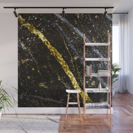 Gold sparkly line on black rock Wall Mural