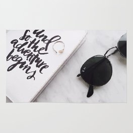 Book and sunglasses Rug