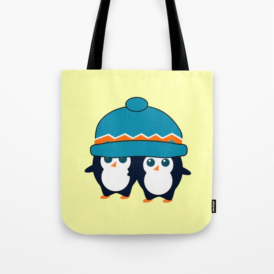 When two cute penguins find a beanie Tote Bag
