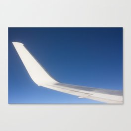 Airplane Wingtip on a blue sky Canvas Print