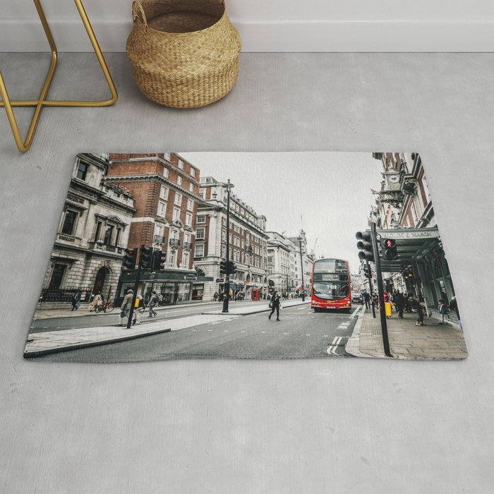 Red bus in Piccadilly street in London Rug