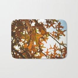 sun through autumn leaves Bath Mat