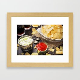 Potato chips with dipping sauces on a rustic table Framed Art Print