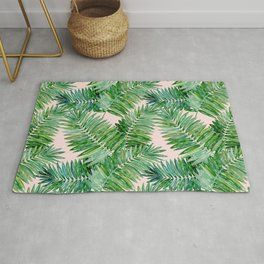 Green palm leaves on a light pink background. Rug
