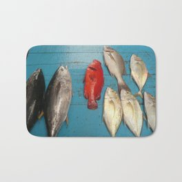 """The red fish in """"blue water"""" Bath Mat"""