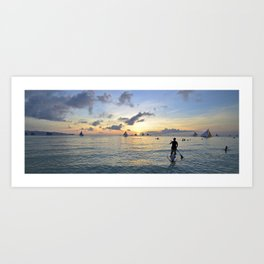 Paddle boarding into the sunset.  Art Print