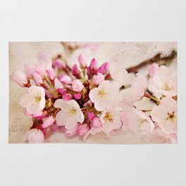 cherry blossoms with typography Rug