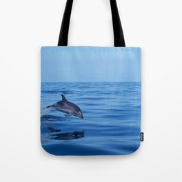 Spotted dolphin jumping in the Atlantic ocean Tote Bag