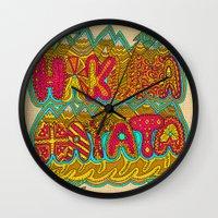 hakuna Wall Clocks featuring Hakuna Color by Diego Tirigall