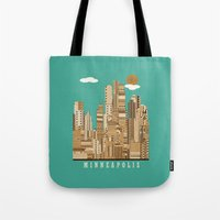 minneapolis Tote Bags featuring Minneapolis skyline by bri.buckley
