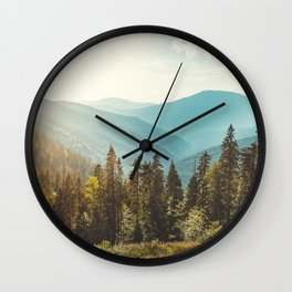Peaceful landscape, mountains and blue sky background.  Wall Clock