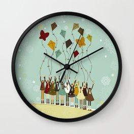 Children flying kites at christmas Wall Clock