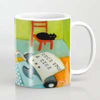 writer Mugs featuring The writer of stories by tascha
