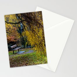 Bench and yellow tree in the autumn park Stationery Cards