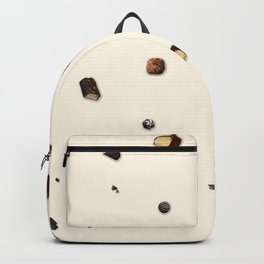 Falling chocolates with cream background Backpack
