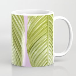 Three large green leaves on a pink background - vivid colors Coffee Mug