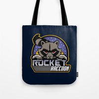 rocket raccoon Tote Bags featuring Rocket Raccoon logo by Buby87