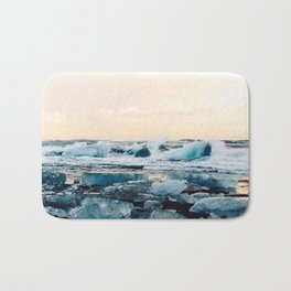 Waves Crashing on the Ice of Diamond Beach, Iceland at Sunset Bath Mat