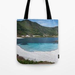 Stunning summer mountain landscape: Blue Lake, green forest on hillsides, blue sky on sunny Tote Bag